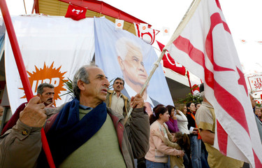 A supporter holds Turkish Cypriot flags during a rally held by the National Unity Party in Iskele.