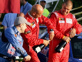 Feghali, Njeim and Feghali pop champagne during award ceremony of Rally of Lebanon in Beirut