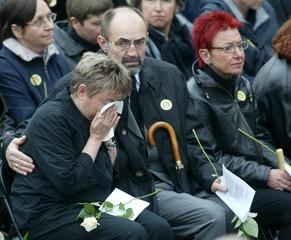 TEACHERS OF THE GUTENBERG SCHOOL MOURN IN FRONT OF THE ERFURT CATHEDRALDURING A CHURCH SERVICE FOR ...