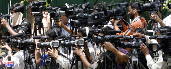 Members of the media gather outside residence of Sonia Gandhi in New Delhi
