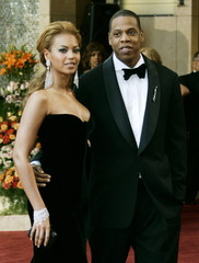 - FILE PHOTO TAKEN 27FEB05 - Entertainers Beyonce (L) and her boyfriend Jay-Z arrive for the 77th an..