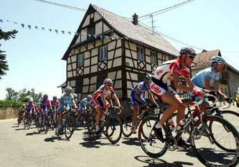 The pack of riders cycle past a traditional Alsacian house during 1st stage of the 93rd Tour de France cycling race in Strasbourg