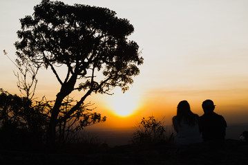 Couple silhouette at sunset in Brazil