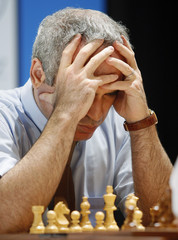 Former chess world champion Kasparov observes the board during the last day of his 25th anniversary match against Karpov in Valencia
