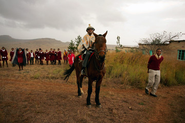 Sotho youth waits on horseback for Irish rock star Bono to arrive at school in Butha Buthe near Lesotho's capital Maseru