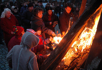 People watch ceremonial burning of dried oak branches in Nis