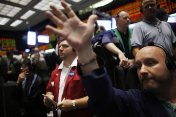 Traders work at the Chicago Mercantile Exchange
