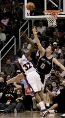 Phoenix Suns Amare Stoudemire scores against San Antonio Spurs Rasho Nesterovic.