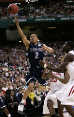 Georgetown University Hoyas' Wallace goes to the basket against Ohio State University Buckeyes'  Lighty during the NCAA Final Four men's semi-final basketball championship in Atlanta