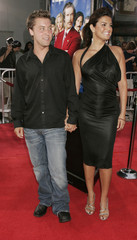 SINGER LANCE BASS WITH ACTRESS JENNIFER GIMENEZ AT PREMIERE OF ANCHORMAN.