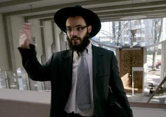 Estonia's Rabbi Kot stands in the new synagogue in Tallinn