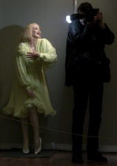 A PHOTOGRAPHER TAKES A PICTURE OF A WAXWORK OF MARILYN MONROE INBUCHAREST.