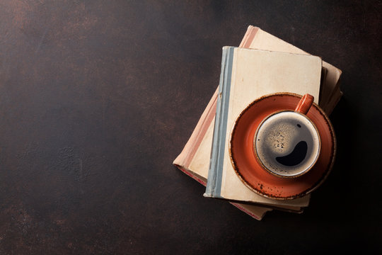 Coffee cup on books