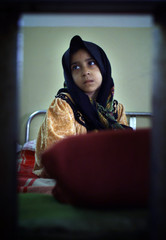 Seven-year-old Iraqi girl Zainab Ali Hussia, suffering from leukemia, sits on her bed in a children ..