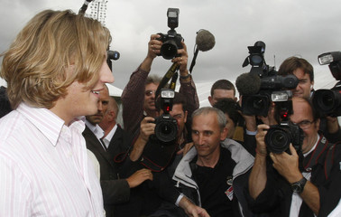 Sarkozy arrives surrounded by journalists at summer meeting of UMP political Party in Royan