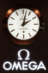 An Omega logo is seen on the Swatch Group showcase on the opening day of the Baselworld in Basel