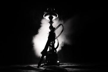 Hookah hot coals on shisha bowl with black background. Stylish oriental shisha