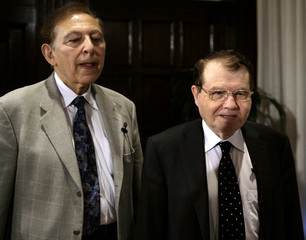 Gallo and Montagnier, co-discoverers of the Human Immunodeficiency Virus (HIV), arrive for a news conference at the National Press Club in Washington