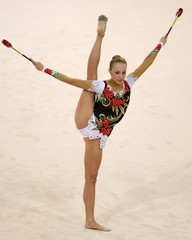 Inna Zhukova of Belarus performs with the clubs during the individual all-around qualification of the rhythmic gymnastics competition at the Beijing 2008 Olympic Games