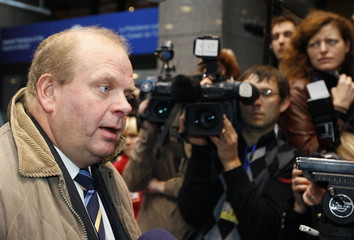Sweden's Agriculture Minister Erlandsson arrives for an extraordinary EU farm ministers meeting in Brussels