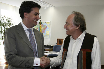 Brazil's Environment Minister Minc shakes hands with British Climate Secretary Miliband during a meeting at the environment ministry in Brasilia