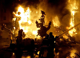 FLAMES ENGULF PUPPETS DURING FALLAS FESTIVAL IN VALENCIA.