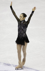 Kim Yu-na of South Korea reacts after competing during the women's short program at the ISU Grand Prix of Figure Skating Final in Goyang