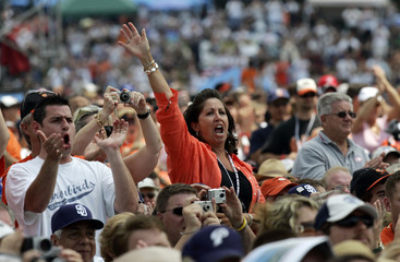 Fans cheer during induction ceremony at National Baseball Hall of Fame in Cooperstown