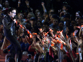 U2 SINGER BONO PERFORMS AT SUPER BOWL XXXVI HALFTIME SHOW.