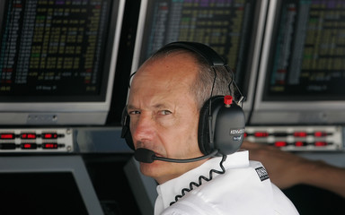 McLaren team director Dennis of Britain looks on during the first practice at Istanbul Park racetrack in Istanbul