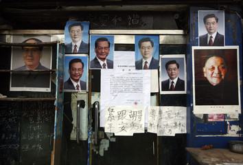Posters of former Chinese leaders Deng and Mao, along with the current Premier Wen and President Hu, are displayed in Beijing