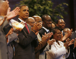 Presumptive U.S. Democratic presidential candidate Senator Obama applauds during services at Apostolic Church of God in Chicago