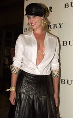Actress and model Rebecca Romijn-Stamos poses as she arrives at a party celebrating the opening of t..