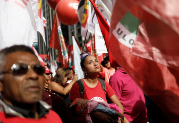Trade unionists take part in a demonstration against Brazil's President Temer on International Labour Day in Sao Paulo