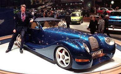 DIRECTOR GENERAL OF MORGAN CHARLES MORGAN POSES WITH A MORGAN AERO8 AT THE GENEVA CAR SHOW.
