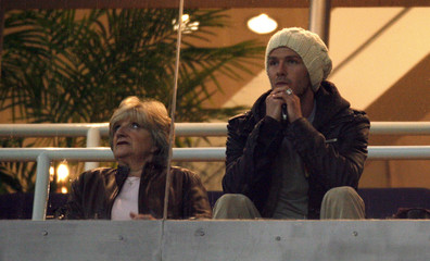 Beckham watches his team's Spanish King's Cup match against Real Betis next to his mother in Madrid