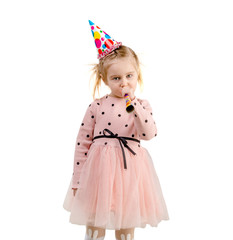 girl wearing birthday cap, isolated on white background