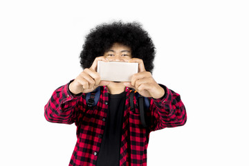 Afro man taking a picture with a smartphone