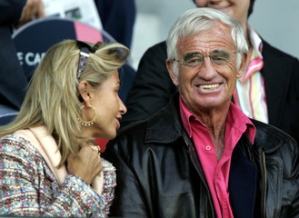French actor Jean-Paul Belmondo (R) and his wife Natty (L) attend a French Ligue 1 soccer match betw..