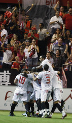Sevilla's players celebrate their first goal against Real Madrid during their Spanish first division soccer league match at Sanchez Pizjuan stadium in Seville