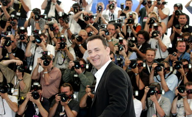 U.S. actor Tom Hanks laughs as he stands in front of a wall of photographers for [U.S. director Joel..