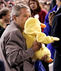 President Bush kisses a baby dressed for Halloween as a chick at a rally in Cincinnati.