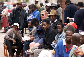 HARARE MALE RESIDENTS QUEUE UP TO VOTE.