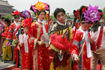 Chinese visitors don imperial costumes at the Forbidden City in Beijing.