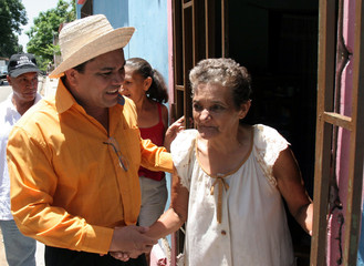 Venezuelan comedian and presidential candidate Rausseo greets an elderly woman in Isla Margarita