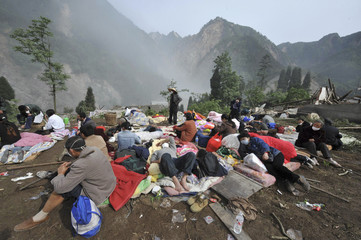 Survivors gather at an open area in Jinhua