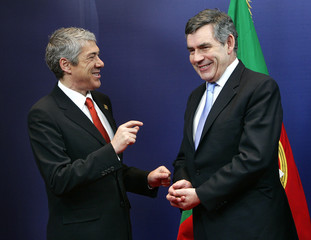 Portugal's Prime Minister Socrates talks with his British counterpart Brown at a EU summit in Brussels
