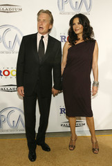 Douglas and his wife Zeta-Jones arrive at the 20th annual Producers Guild Awards at The Hollywood Palladium in Los Angeles