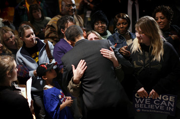 Democratic presidential candidate Senator Obama embraces a supporter during a campaign rally stop in Waterloo