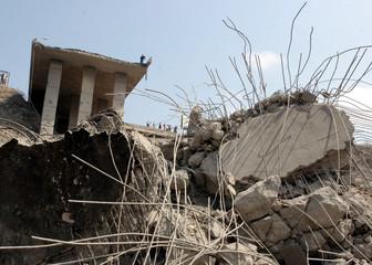A Lebanese civilian stands above the damaged Halat bridge after its destruction by Israeli war planes